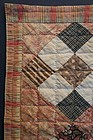 Nice early doll quilt from an even earlier full sized quilt chintz