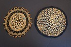 "Two braided antique candle stick mats 19th C.  5"" and 6"" dia."