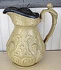 Buff Colored Relief Molded Stoneware Wine Jug, c. 1830