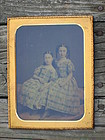 Full plate of two sisters in identical dresses c. 1850