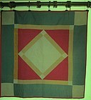 An Amish pieced Diamond in Square quilt dated 1916