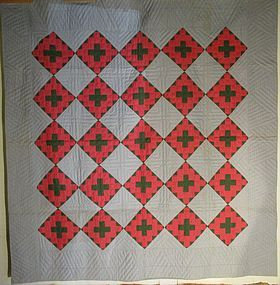 Geometric pieced cotton American quilt circa 1900