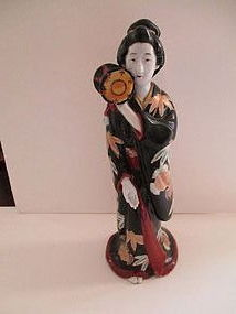 Kutani porcelain Bijin with a drum Meiji c. 1890