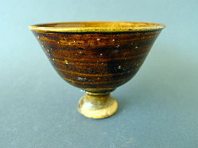 A 14th century Amber glazed Stem-cup