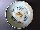 A Ming Hongwu blue and white dish with biscuit fish