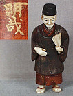 19c lacquer netsuke MERCHANT with fan by MEISAI