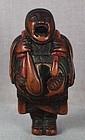 19c netsuke PILGRIM with BUDDHIST GONG