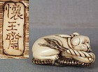 19c netsuke PUPPY on sandal by KAIGYOKUSAI MASATERU