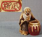 Netsuke POET LI PO & wine jar by RYUFU