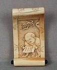 18c netsuke scroll with KANZAN with scroll