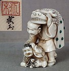 Netsuke Grandfather shishi mask boy hobby horse by ROGYOKU