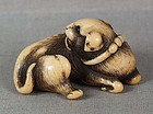18c Kyoto school netsuke DOG licking its fur
