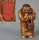 19c netsuke Chinese elder with basket by YOSHIYAMA