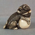 Early 19c Kyoto netsuke DOG with ball