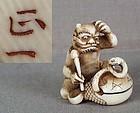 19c netsuke ONI NO NEMBUTSU gong snake by MASAKAZU