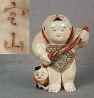19c netsuke BOY with puppy by HOZAN