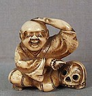19c netsuke POET / PRIEST IKKYU with skull