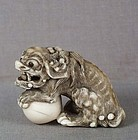 Early 19c netsuke SHISHI with ball
