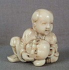 Early 19c netsuke BOY with MASK
