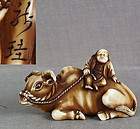 19c netsuke man on buffalo by RYUKEI