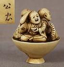 Netsuke THREE SHOJO in a cup by YUKIMASA