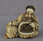 18c netsuke SENNIN with basket
