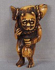 19c netsuke ONI with sake & fish