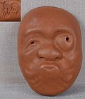 19c netsuke mask perplexed peasant by SEKISEN