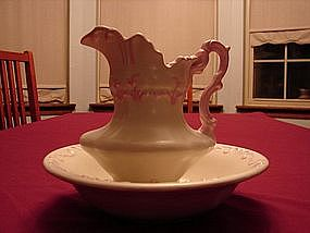 Nice Ceramic bowl and pitcher. Cream with pink trim.