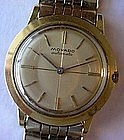 14K GENT'S MOVADO AUTOMATIC WRIST WATCH AU CASE & BAND