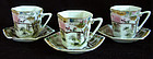 Set of 3 matching porcelain hand painted cups saucers