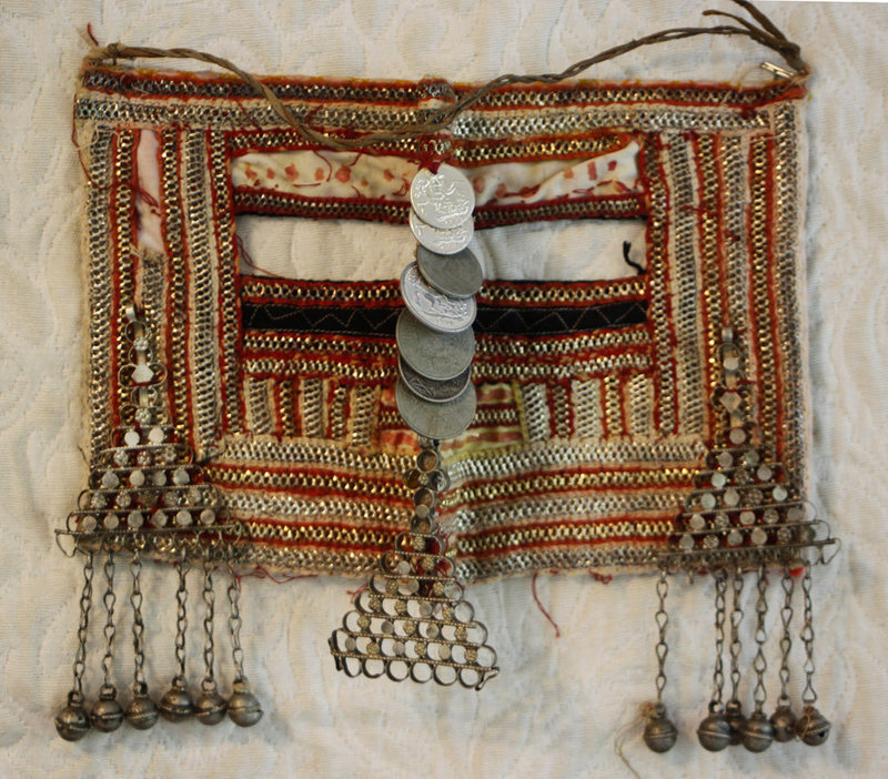 Woman's ornate tribal face cover from Saudi Arabia