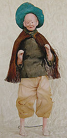 Antique Chinese farmer doll with raincoat