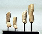 AN ANCIENT CYCLADIC GROUP OF MARBLE LEGS