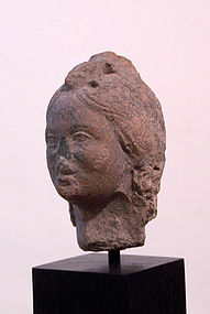 AN ANCIENT ROMAN TERRACOTTA  HEAD OF A WOMAN