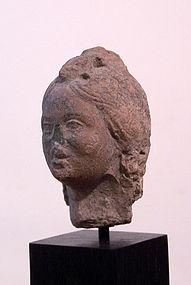 AN ANCIENT ROMAN TERRACOTTA  HEAD OF A WOMAN