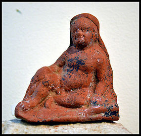 AN ANCIENT GREEK TERRACOTTA FIGURE OF A BOY