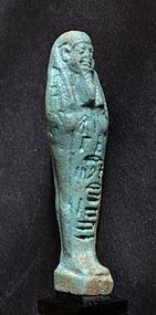 AN ANCIENT EGYPTIAN FAIENCE SHABTI