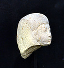 AN ANCIENT EGYPTIAN LIMESTONE HEAD