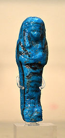 AN ANCIENT EGYPTIAN BRILLIANT BLUE FAIENCE SHABTI