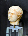 AN ANCIENT ROMAN MARBLE HEAD OF A MAN