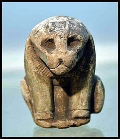 AN ANCIENT EGYPTIAN FAIENCE BUST OF SEKHMET