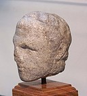 AN ANCIENT EGYPTIAN MARBLE HEAD OF A PTOLEMAIC PRINCE