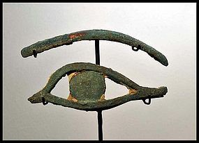 AN ANCIENT EGYPTIAN BRONZE EYE AND EYEBROW