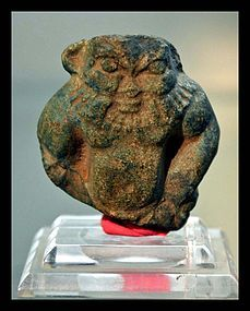 AN ANCIENT EGYPTIAN FAIENCE BES