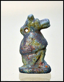 AN ANCIENT EGYPTIAN FAIENCE BABOON AMULET
