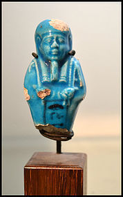 AN ANCIENT EGYPTIAN BLUE FAIENCE SHABTI