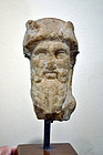 AN ANCIENT ROMAN MARBLE HERM OF DIONYSUS