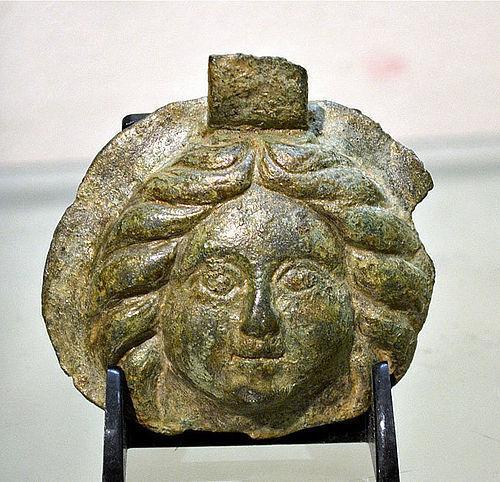 AN ANCIENT ROMAN BRONZE HEAD OF A GORGONEION