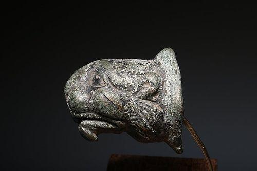 AN ANCIENT ROMAN BRONZE LION HEAD APPLIQUE